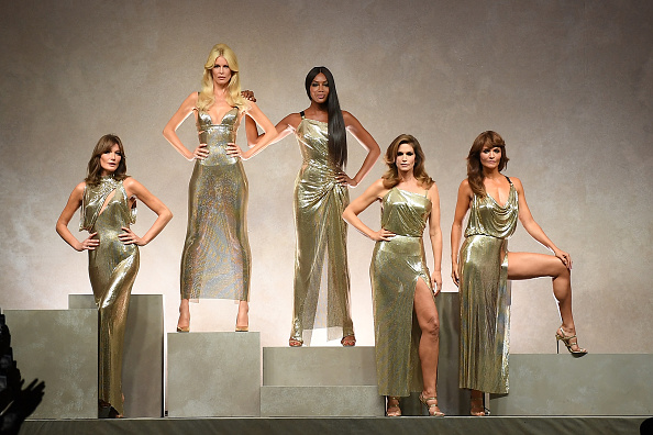 MILAN, ITALY - SEPTEMBER 22: Carla Bruni, Claudia Schiffer, Naomi Campbell, Cindy Crawford and Helena Christensen walk the runway at the Versace show during Milan Fashion Week Spring/Summer 2018 on September 22, 2017 in Milan, Italy.  (Photo by Venturelli/WireImage)