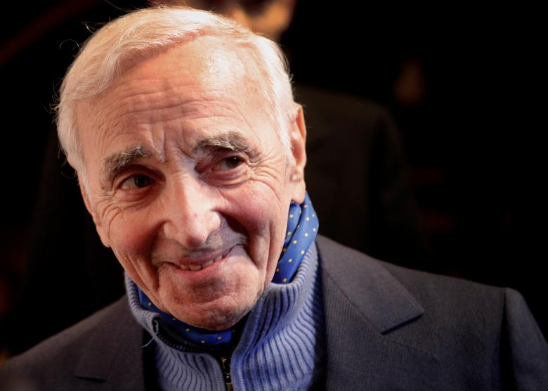 "French singer Charles Aznavour, who stole the hearts of millions with decades of haunting love songs, died October 1 aged 94. The singer, who sold more than 100 million records in 80 countries, began his career peddling his words and music to the Paris boulevardiers of the 40s and 50s - Edith Piaf, Maurice Chevalier, Charles Trenet. But it became evident that Aznavour himself best interpreted the bittersweet emotions of such songs as ""Hier Encore"" (Yesterday When I Was Young), ""Apres l'Amour"" (After Love) and ""La Boheme."" Others were ""She"" and ""Formidable."" Sometimes described as France's Frank Sinatra, Aznavour was born in Paris in 1924 to Armenian parents - his birth name Shahnour Aznavourian. In his autobiography, ""Aznavour by Aznavour,"" he recalls that after a period trying to play the role of a tough guy, he was goaded one evening into climbing on the bandstand to sing. ""There, I had a revelation. I saw that the girls looked at me much more, their eyes moist and their lips apart, than when I played a terror ... I was only 15 or 16, but I understood,"" he wrote.  REUTERS/Christophe Ena/Pool"